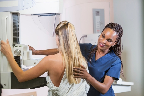 Woman receiving a mammogram