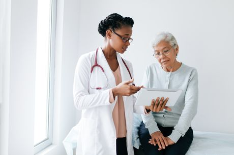 Doctor and patient review mammogram results.