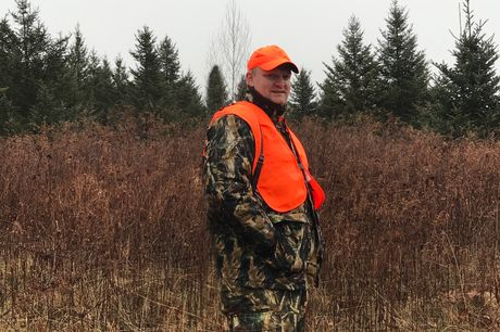 A hunter in orange hunting gear