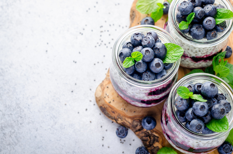 Greek yogurt parfait topped with fresh blueberries.