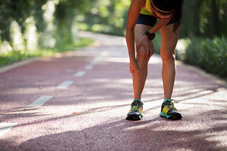 Woman runner experiences pain from shin splints
