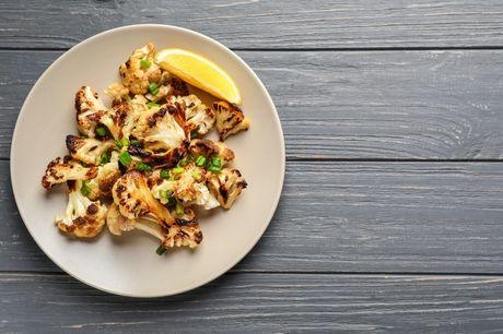 Grilled cauliflower steaks with beans and walnut pesto