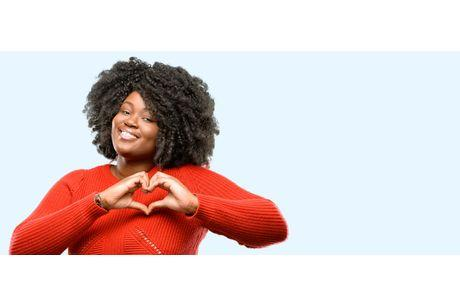 Woman holding heart with her hands. Stay heart healthy with Geisinger