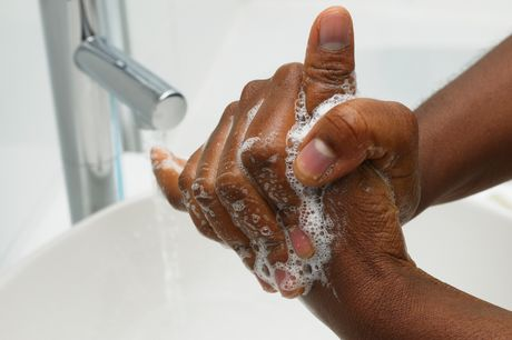 A man washing his hands to protect himself against flu and other illness.