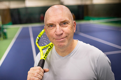 Middle-aged man now pain-free after vascular surgery and able to play tennis again