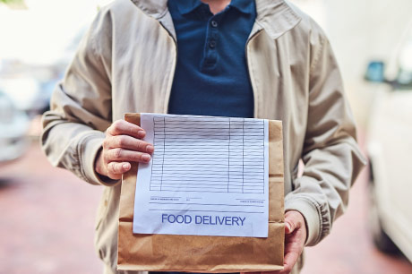 Delivery person with food order