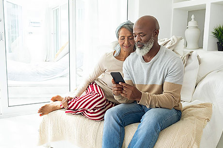 Middle-aged couple looking at health information online