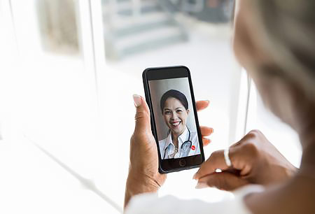 Female patient on a telemedicine call with her physician