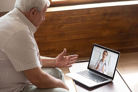 Male patient on a telemedicine call with physician