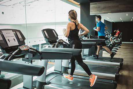 Runners at the gym wearing masks to prevent the spread of Coronavirus.