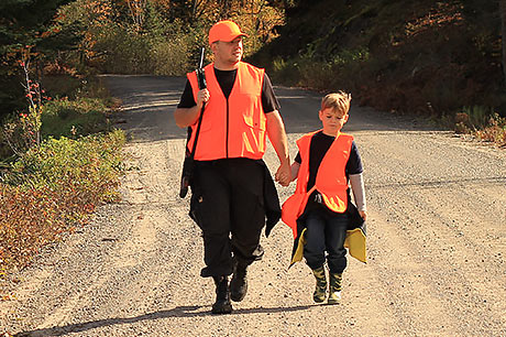 Father and young son spend the day hunting for deer.