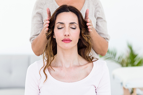 A woman receiving integrative medicine