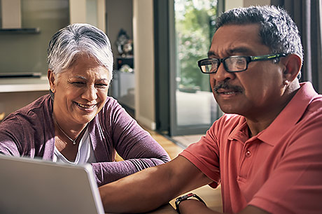 Older couple reviewing their Medicare plan options online.