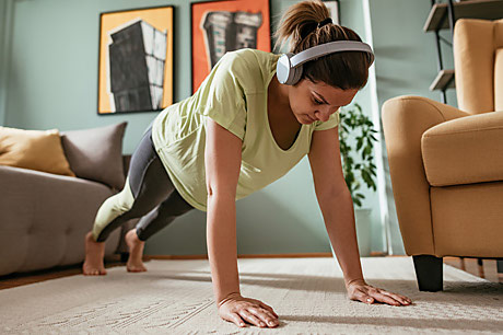 Young woman excercising at home.