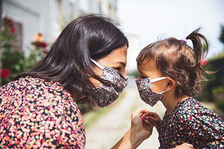 A mom & daughter wearing masks