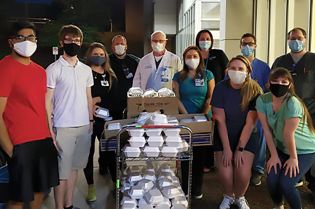 Geisinger Commonwealth School of Medicine students prepare to donate meals to the community.