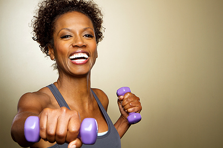 Woman exercising with purple dumbbells