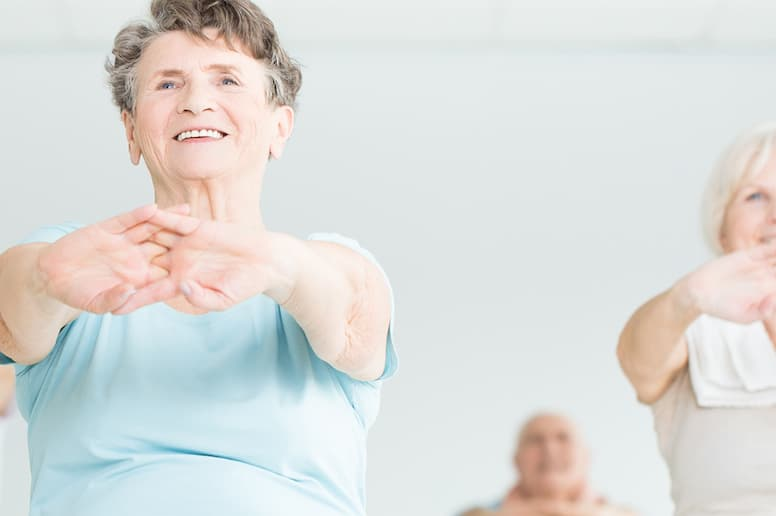 Several seniors in an exercise class