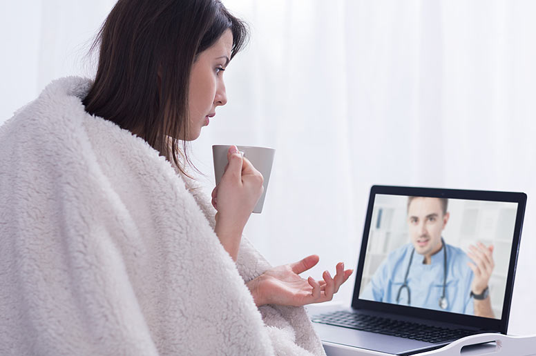 Patient discussing with doctor via laptop - Telemedicine