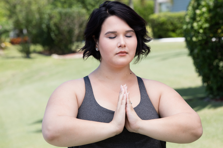 overweight woman doing yoga