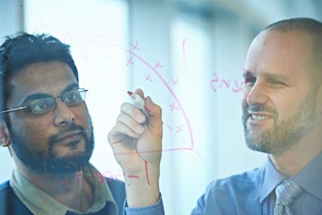 Two men at see-through white board