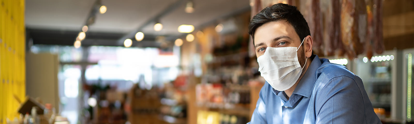 Business owner wearing protective mask to prevent the spread of COVID-19