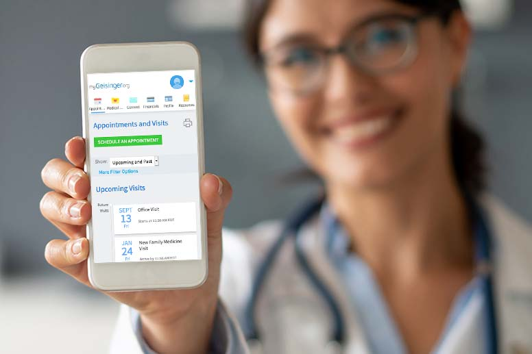 doctor holding up a phone showing you the mygeisinger app